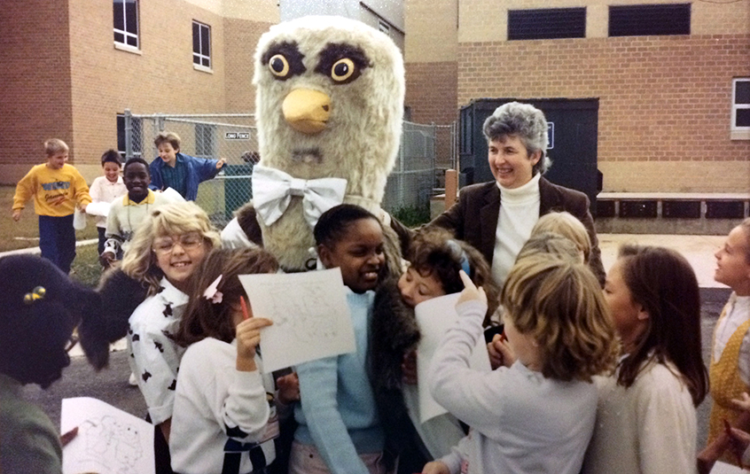 Photograph of Silverbrook students gathered around a person wearing the Seahawk mascot costume.