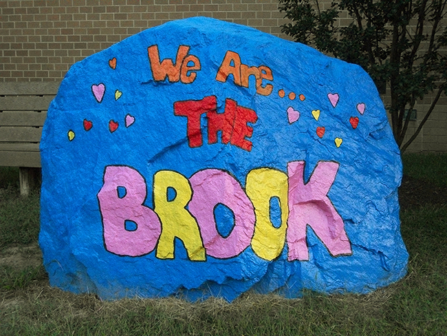 Photograph of the large boulder that was installed in front of Silverbrook to serve as the school's spirit rock.